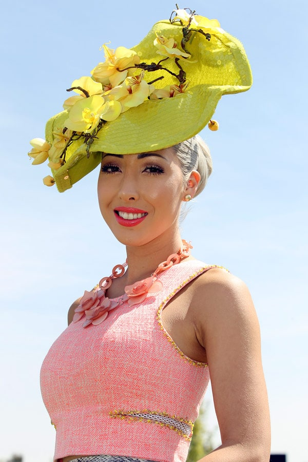 Yellow hat pink top Flemington Fashions on the field