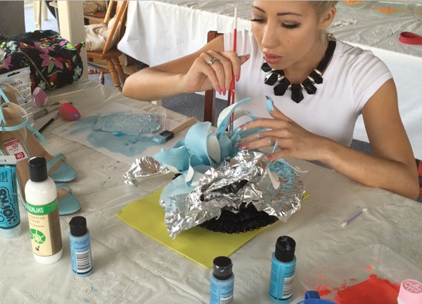 Paint embellishments to reuse hats