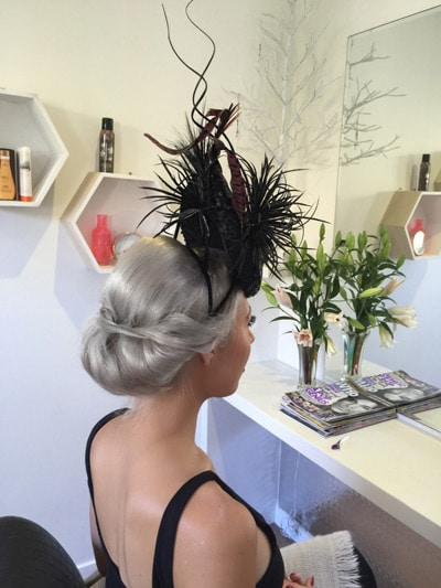black spiky feathers reuse hat