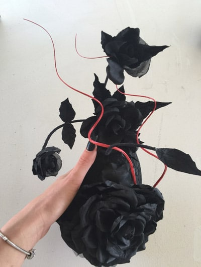 red millinery quill black hat