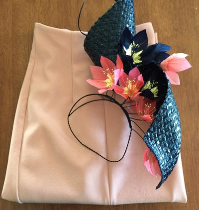 navy swirl millinery and pink skirt