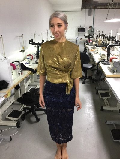 Milano wearing gold sequin top and Alice McCall skirt