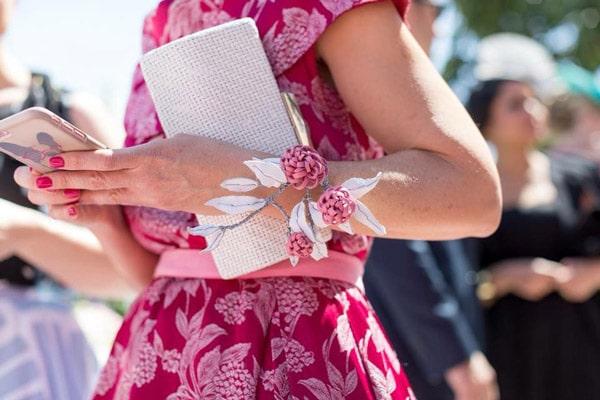 floral brooch worn on wrist