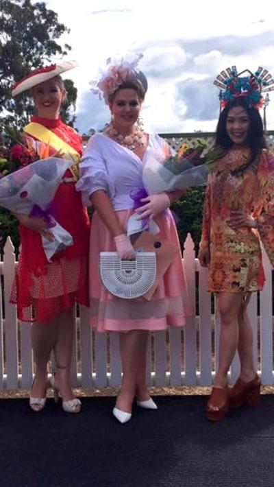 Dahyna-Heenan wearing pink lavender racewear dress