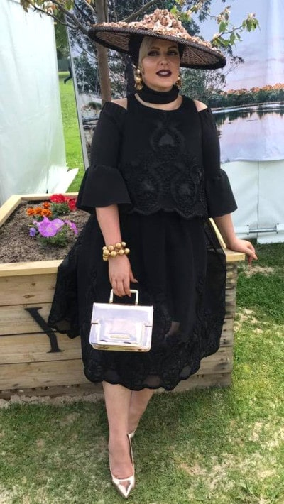 Dahyna Heenan wearing black racewear dress