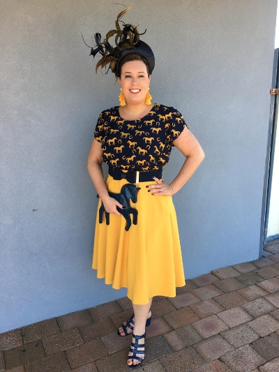 Shantelle Morris wearing yellow skirt and black top