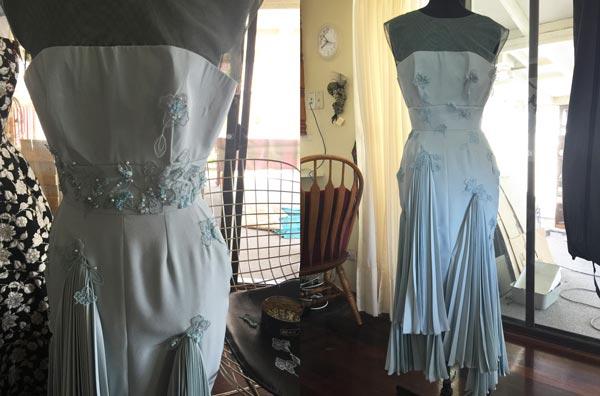 pinning lace embellishments onto race dress