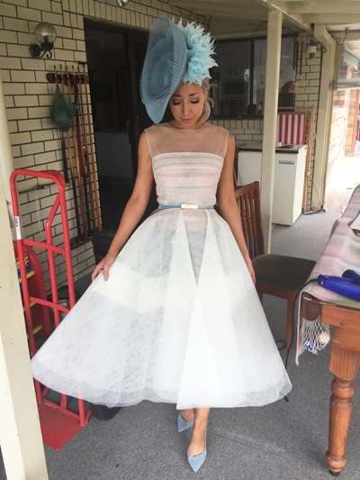 oaks day blue fascinator with white tulle race dress