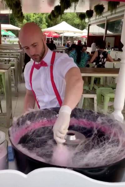 man making fairy floss
