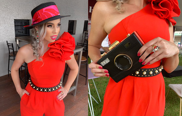 bright red pant suit for girls day out camera clutch accessory